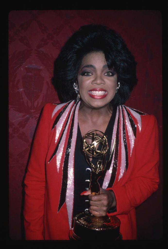 "(Original Caption) : 1987: Television talk show host ""Oprah Winfrey "" smiles while holding an Oscar statuette.   (Photo by LGI Stock/Corbis/VCG via Getty Images)"