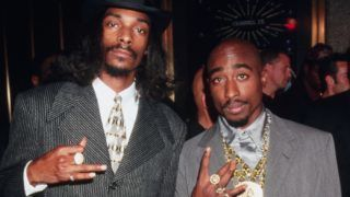 Rappers Snoop Doggy Dogg (left) and Tupac Shakur flash gang signs while attending the 1996 MTV Video Music Awards at Radio City Music Hall.   (Photo by Mitchell Gerber/Corbis/VCG via Getty Images)