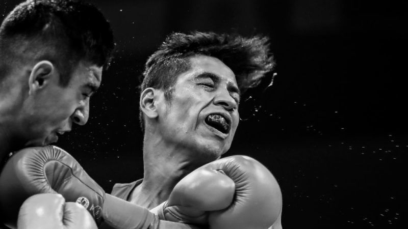 HAMBURG, GERMANY - AUGUST 31:  (EDITORS NOTE: This image has been converted to black and white) Freudis Rojasi (R) of USA and Ikboljon Kholdarov of Uzbekistan fight in the Men's light welter during the semi finals of the AIBA World Boxing Championships Hamburg 2017 at Sporthalle Hamburg on August 31, 2017 in Hamburg, Germany. (Photo by Martin Rose/Bongarts/Getty Images)