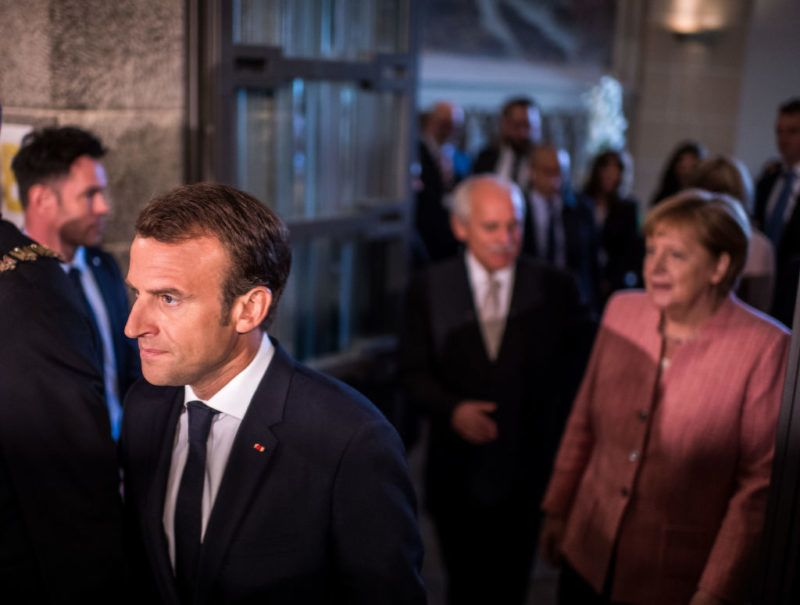 AACHEN, GERMANY - MAY 10: German Chancellor Angela Merkel (R-L) and French President Emmanuel Macron arrive for the International Charlemagne Prize at a ceremony on May 10, 2018 in Aachen, Germany. The award, bestowed annually since 1950, is given to honor leaders who have furthered European unity. (Photo by Lukas Schulze/Getty Images,)