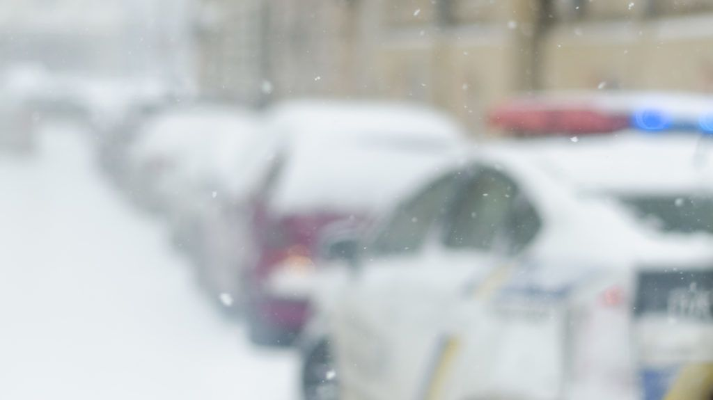 Blurred winter background police car city life bad weather lifestyle blizzard christmas cold falls snow tourists panorama old city