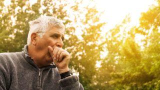 Coughing Senior Man on fresh air.