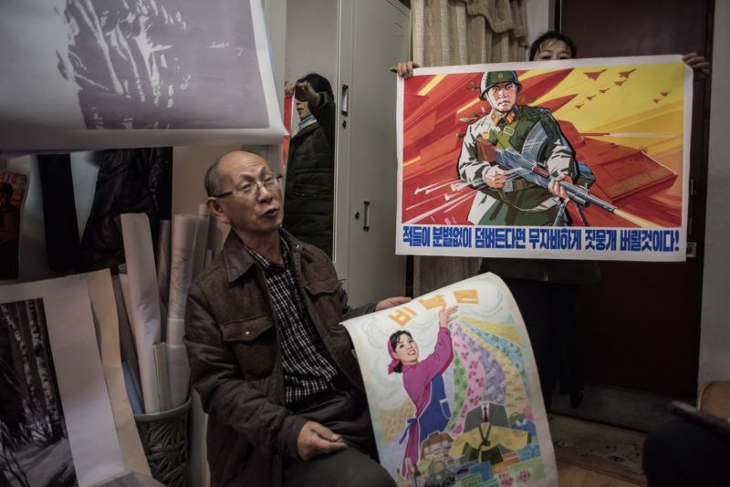 In a photo taken on November 29, 2016 artist Hong Chun-Ong (Hong Choon) speaks to AFP in his studio at the Mansudae Art Studio complex in Pyongyang. - Mansudae's socialist-realist style has proved popular with revolutionary movements-turned-governments looking to create a post-colonial memorial landscape, and it provides skilled workers at a very competitive price. (Photo by Ed JONES / AFP) / TO GO WITH AFP STORY NKOREA-ART-ECONOMY-SANCTIONS,FEATURE BY GILES HEWITT  RESTRICTED TO EDITORIAL USE - MANDATORY MENTION OF THE ARTIST UPON PUBLICATION - TO ILLUSTRATE THE EVENT AS SPECIFIED IN THE CAPTION