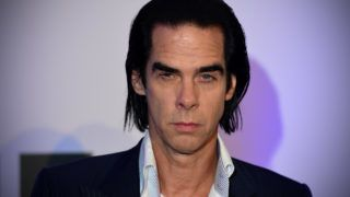 Australian musician and actor Nick Cave arrives for the gala screening of 20,000 Days on Earth in central London on September 17, 2014. AFP PHOTO / CARL COURT (Photo by CARL COURT / AFP)