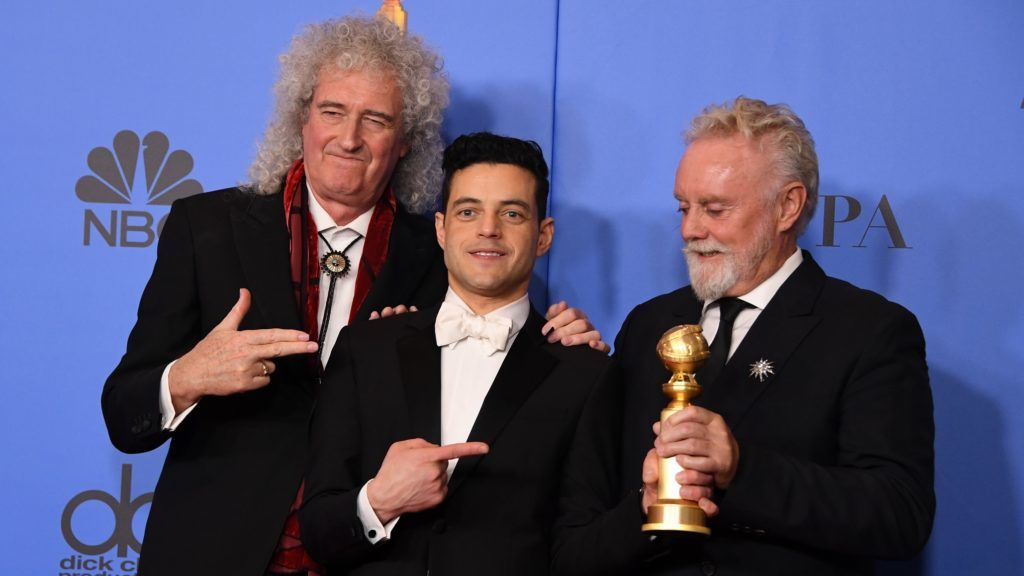 """Best Actor in a Motion Picture – Drama for """"Bohemian Rhapsody"""" winner Rami Malek poses with Queen band members Roger Taylor (R) and Brian May (L) during the 76th annual Golden Globe Awards on January 6, 2019, at the Beverly Hilton hotel in Beverly Hills, California. (Photo by Mark RALSTON / AFP)"""