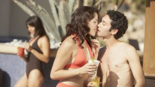 Young Hispanic couple kissing, Los Cabos, Mexico