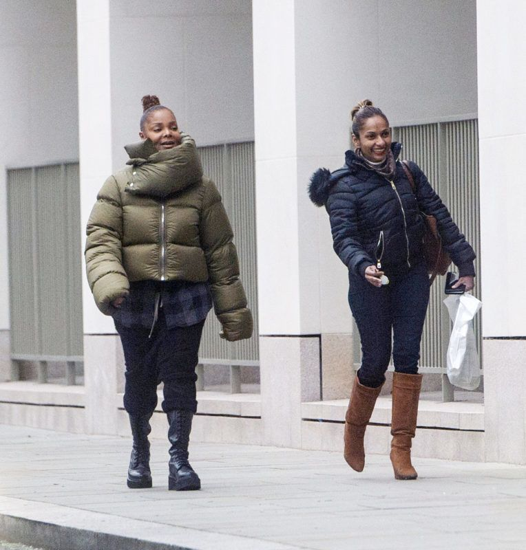 01/03/2019 EXCLUSIVE: Janet Jackson steps out with some birthday balloons for her son Eissa Al Mana second birthday in London. The 52 year old singer was bundled up in a green puffer jacket, black trousers, and black boots. Jackson's helpers could also be seen delivering a cake, potted plant, and a cactus.   sales@theimagedirect.com Please byline:TheImageDirect.com  *EXCLUSIVE PLEASE EMAIL sales@theimagedirect.com FOR FEES BEFORE USE January 3, 2019