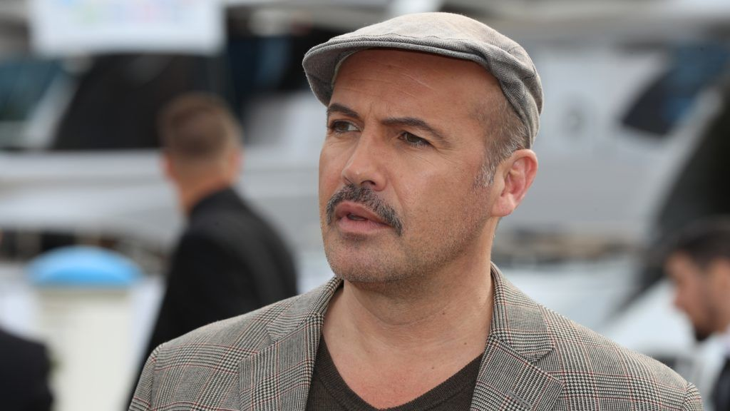 """US actor Billy Zane poses during a photo call for a TV series """"Curfew"""" as part of the MIPCOM, on October 15, 2018 in Cannes, southeastern France. (Photo by VALERY HACHE / AFP)"""