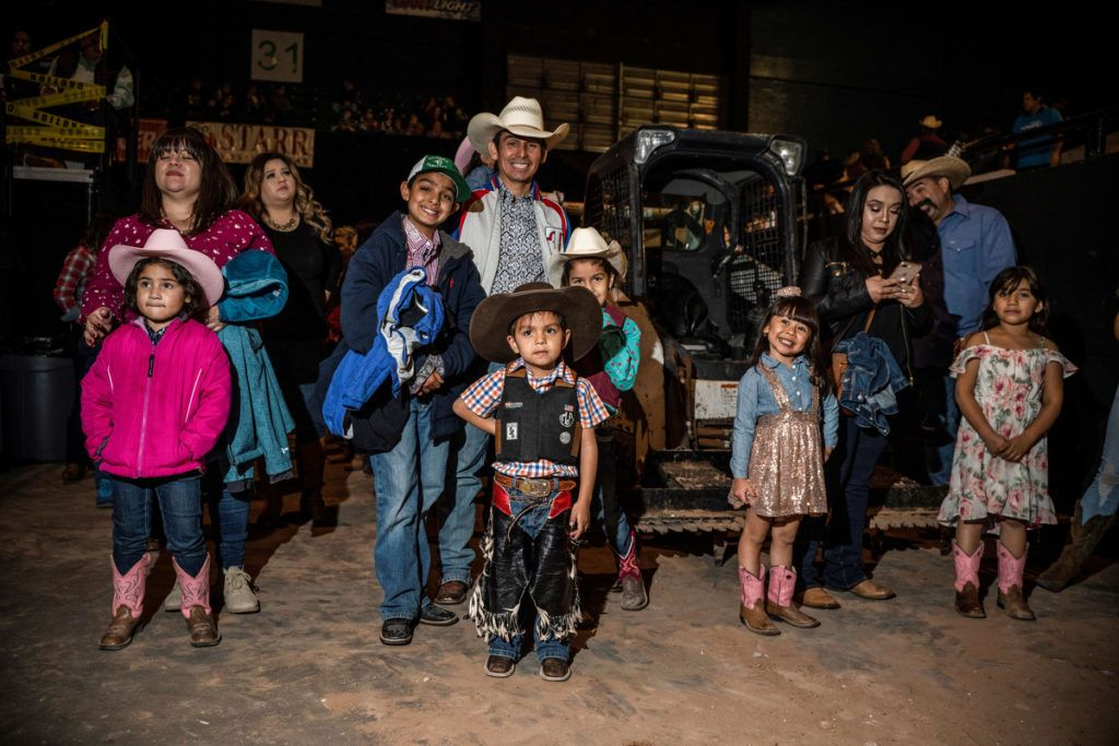 """Kids participating in """"Stick Bull Riding"""" are pictured before the event at the El Paso County Colosseum before the Tuff Hedeman Bull Riding Tour on February 16, 2019. - About 25 riders competed for about $30,000 in prize money for this Tuff Hedeman Bull Riding Tour stage named after the four time bull riding world champion who grew up in El Paso, Texas. (Photo by PAUL RATJE / AFP)"""