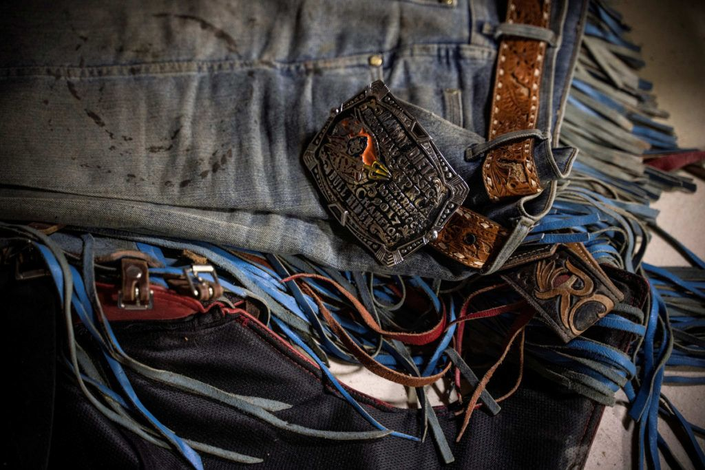 Rider Roscoe Jarboe's belt buckle and jeans are pictured inside the locker room after the Tuff Hedeman Bull Riding Tour at the El Paso County Colosseum on February 16, 2019. - About 25 riders competed for about $30,000 in prize money for this Tuff Hedeman Bull Riding Tour stage named after the four time bull riding world champion who grew up in El Paso, Texas. (Photo by PAUL RATJE / AFP)