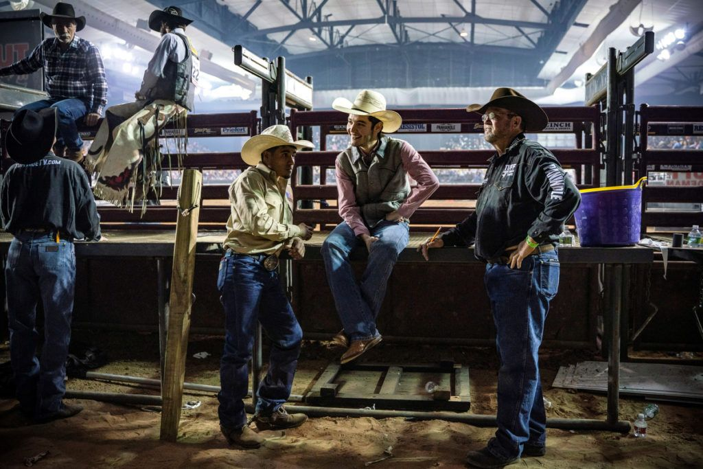 Staff and riders hang out by the chutes during an intermission of the Tuff Hedeman Bull Riding Tour at the El Paso County Colosseum, on February 16, 2019. - About 25 riders competed for about $30,000 in prize money for this Tuff Hedeman Bull Riding Tour stage named after the four time bull riding world champion who grew up in El Paso, Texas. (Photo by PAUL RATJE / AFP)