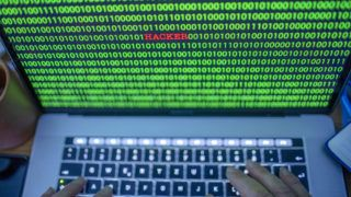 """04 January 2019, Mecklenburg-Western Pomerania, Schwerin: ILLUSTRATION - Between the binary code on a laptop monitor you can see the text """"Hacker"""". (posed photo) Photo: Jens Büttner/dpa-Zentralbild/ZB"""