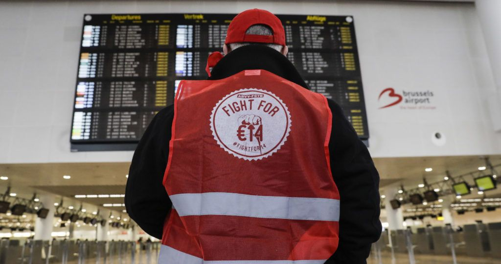 An ABVV-FGTB union member stands at Brussels national airport in Zaventem, on the outskirts of the Belgium capital, on February 13, 2019, during a national general strike. - Belgian airspace was to be closed to all flights below 8,000 metres on February 12 as a national strike threatened to bring the European country to a standstill. (Photo by THIERRY ROGE / BELGA / AFP) / Belgium OUT