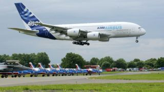 (FILES) This file photo taken on June 20, 2009 shows an Airbus A380 landing during the 48th international Paris Air Show. - European aerospace giant Airbus said on February 14, 2019 it would end production of the A380 superjumbo, the double-decker jet which earned plaudits from passengers but failed to win over enough airlines to justify its massive costs. (Photo by PIERRE VERDY / AFP)