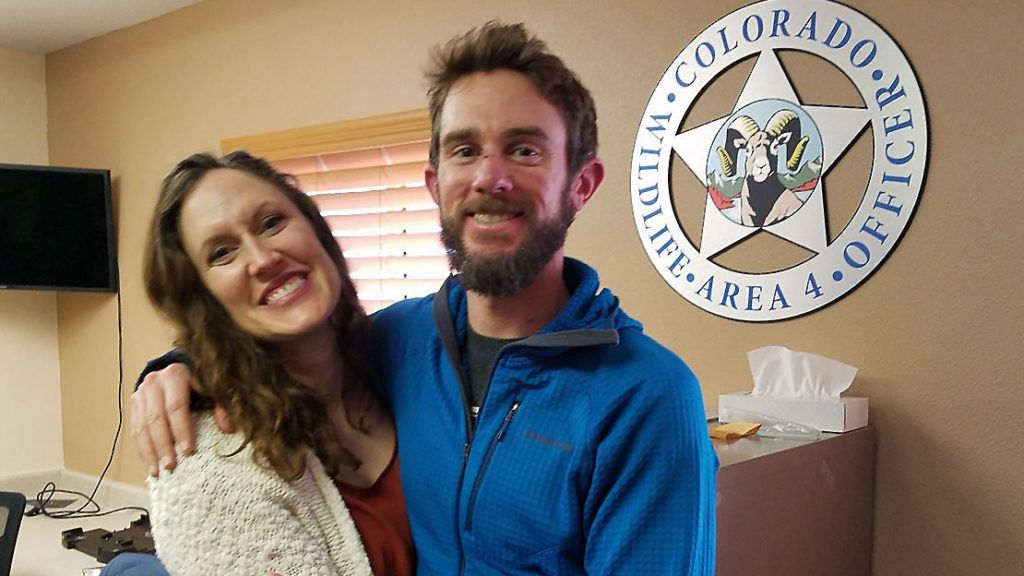 """This picture taken on February 14, 2019, and obtained courtesy of the Colorado Parks and Wildlife shows Travis Kauffman and Annie Bierbouer embracing moments before a press conference after surviving a mountain lion attack in Denver, Colorado. - A Colorado trail runner who survived a mountain lion attack by suffocating the animal said on February 14, 2019, that the encounter that has made him the stuff of legend was """"a fight for survival."""" """"One of the thoughts that I was having was: 'Well this would be a pretty crappy way to die',"""" Kauffman told reporters in his first public comments about the February 4 attack. Kauffman said he had gone out for a run when he was ambushed by the 80-pound (36-kilogram) cat. (Photo by HO / Colorado Parks & Wildlife / AFP) / RESTRICTED TO EDITORIAL USE - MANDATORY CREDIT """"AFP PHOTO / COLORADO PARKS & WILDLIFE"""" - NO MARKETING NO ADVERTISING CAMPAIGNS - DISTRIBUTED AS A SERVICE TO CLIENTS ---"""