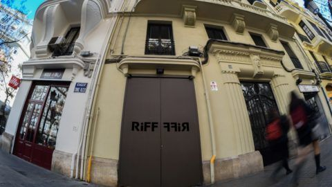 People walk by the entrance of the Riff restaurant in Valencia on February 22, 2019. - A woman who died after eating at the Michelin-starred Riff restaurant in Spain may have suffered food poisoning, a local court said. Another 29 people who ate at the restaurant in the three days before her death also developed food poisoning. (Photo by JOSE JORDAN / AFP)