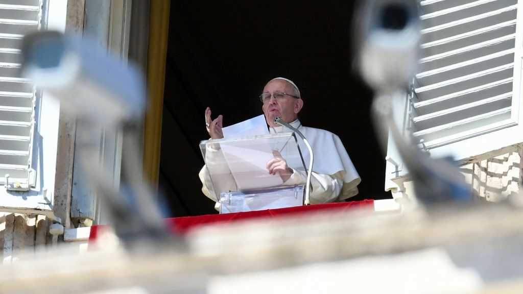 Pope Francis delivers his message from the window of the Apostolic palace as he arrives for the weekly Angelus prayer on February 24, 2019 at the Vatican. - CCTV cameras are seen in foreground. (Photo by Vincenzo PINTO / AFP)