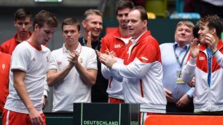 02 February 2019, Hessen, Frankfurt/Main: Tennis: Davis Cup, qualification round Germany - Hungary in the Fraport Arena. Hungary's David Szintai (2nd from left) gets applause from Peter Nagy (3rd from right), Gabor Borsos (M), team captain Gabor Köves (3rd from right) and Zsombor Piros (r) after his defeat against Germany's Kohlschreiber. Photo: Arne Dedert/dpa