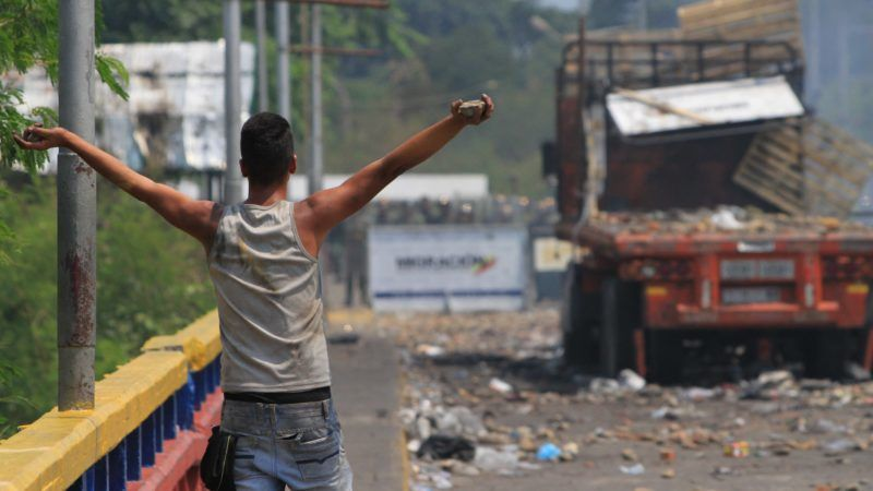TACHIRA, VENEZUELA - FEBRUARY 24: A protester holds a rock in his hand at the Francisco de Paula Santander Bridge in Tachira, Venezuela on February 24, 2019. Two international bridges and their surroundings had a quiet day except for small scale clashes. Venezuelan security forces deployed at the bridge after a group of ten protesters threw rocks from under the bridge and only two protesters climbed up Francisco de Paula Santander Bridge.  Daniel Salgar Antolinez / Anadolu Agency