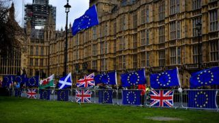 Anti Brexit demonstrators gather outside the Houses of Parliament, waving EU and Union Flags, and placards to protest against Brexit, London on February 12, 2019. (Photo by Alberto Pezzali/NurPhoto)
