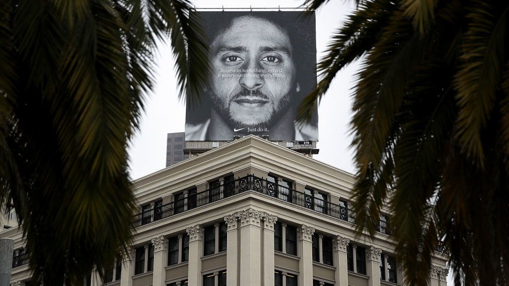 """SAN FRANCISCO, CA - SEPTEMBER 05:  A billboard featuring former San Francisco 49ers quaterback Colin Kaepernick is displayed on the roof of the Nike Store on September 5, 2018 in San Francisco, California. Nike launched an ad campaign to commemorate the 30th anniversary of its iconic """"Just Do It' motto that features controversial former NFL quarterback Colin Kaepernick and a message that says """"Believe in something. Even if it means sacrificing everything.""""  (Photo by Justin Sullivan/Getty Images)"""