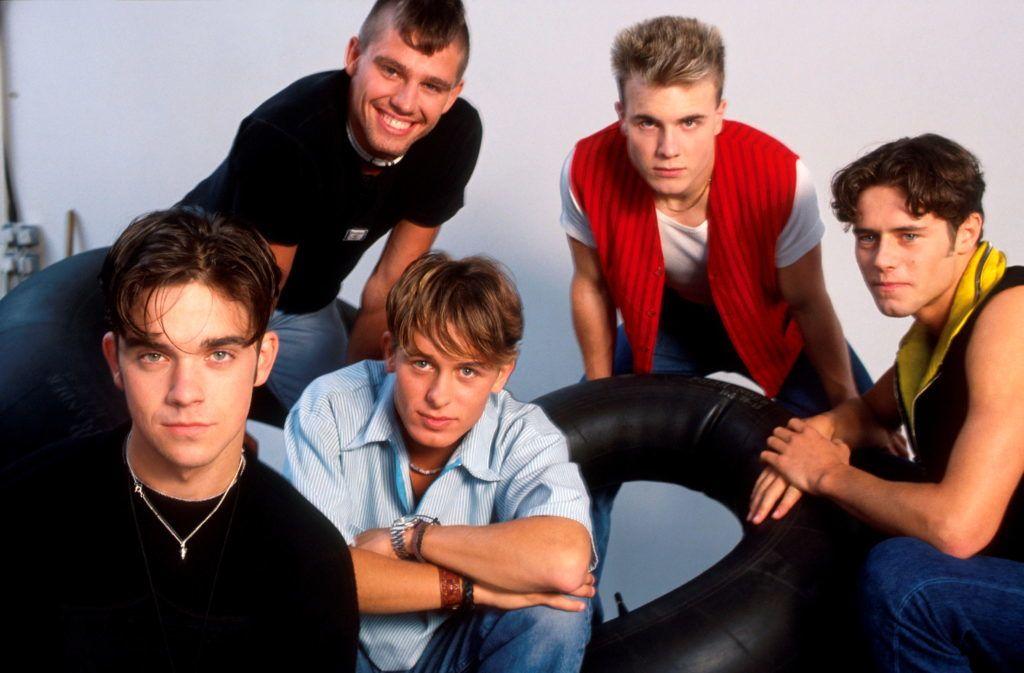 Take That, studio group portrait, London, 1991, L-R Robbie Williams, Jason Orange, Mark Owen, Gary Barlow, Howard Donald. (Photo by Michael Putland/Getty Images)
