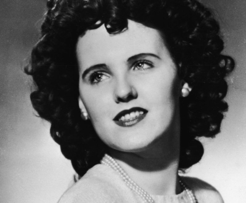Studio headshot portrait of aspiring American actress and murder victim Elizabeth Short (1924 - 1947), 1940s. Short became known as the Black Dahlia after her body was discovered in a vacant lot in Hollywood, California, her corpse naked and severed in two. The murder still remains unsolved. (Photo by INTERNATIONAL NEWS PHOTO/Getty Images)