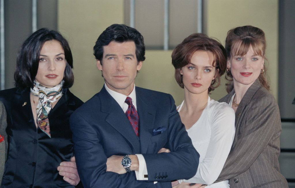 Irish actor Pierce Brosnan poses with his co-stars Famke Janssen (left), Izabella Scorupco (second from right) and Samantha Bond (right) during a publicity shoot for the James Bond film 'GoldenEye', UK, 22nd January 1995. (Photo by Larry Ellis Collection/Getty Images)
