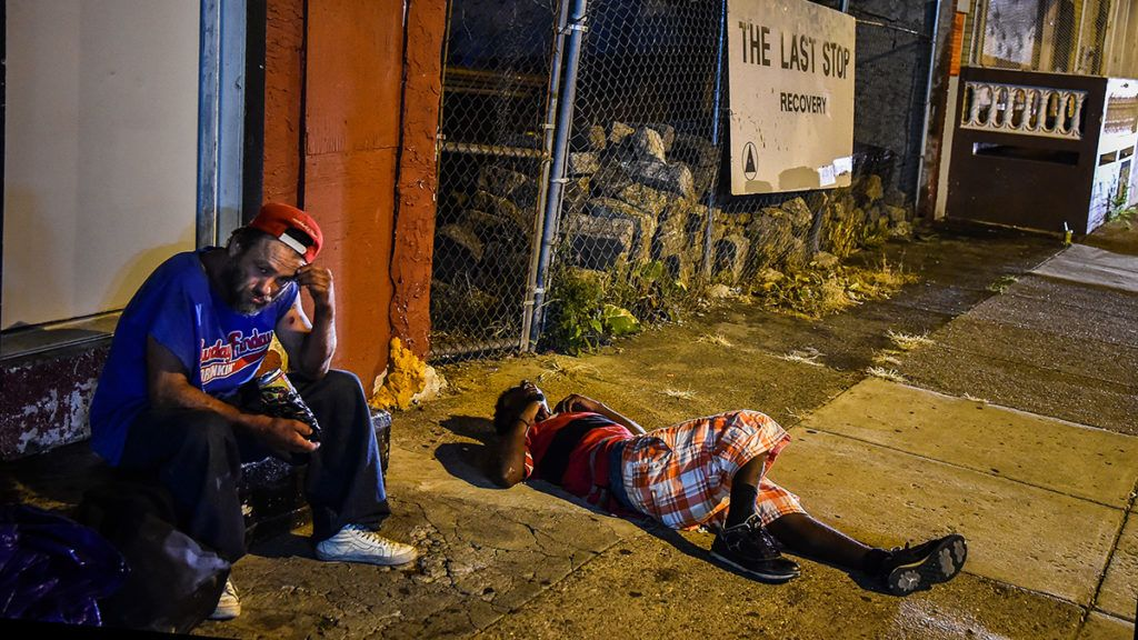 PHILADELPHIA, PA - JULY 20: Art Gutierrez, 42, left, sits at a store front steps across from The Last Stop on Thursday, July 20, 2017, in Philadelphia, PA. Gutierrez who grew up in California, has been using heroin for two year and during that these two years he has contracted HIV and Hep C. He also watched a friend die from a lethal dose of fentanyl. He sells clean needles called works to support his habit. (Photo by Salwan Georges/The Washington Post via Getty Images)