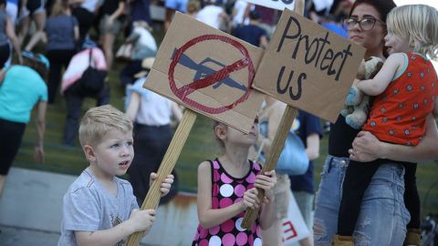 FORT LAUDERDALE, FL - FEBRUARY 17:  Reef Buehler,4, joins his parents and others after a school shooting that killed 17 to protest against guns on the steps of the Broward County Federal courthouse on February 17, 2018 in Fort Lauderdale, Florida. Earlier this week former student Nikolas Cruz opened fire with a AR-15 rifle at the Marjory Stoneman Douglas High School killing 17 people.  (Photo by Joe Raedle/Getty Images)