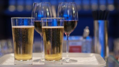 Two glasses of beer in tray ready to serve.
