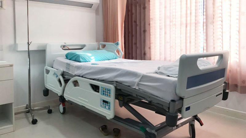 Empty hospital bed for patient, healthy concept