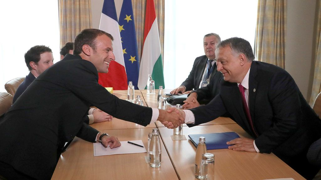 French President Emmanuel Macron (L) shakes hands with Hungary's Prime Minister Viktor Orban as they arrive for a meeting during an EU-Western Balkans Summit in Sofia on May 17, 2018. - European Union leaders will meet their Balkan counterparts to hold out the promise of closer links to counter Russian influence, while steering clear of openly offering them membership. (Photo by ludovic MARIN / AFP)