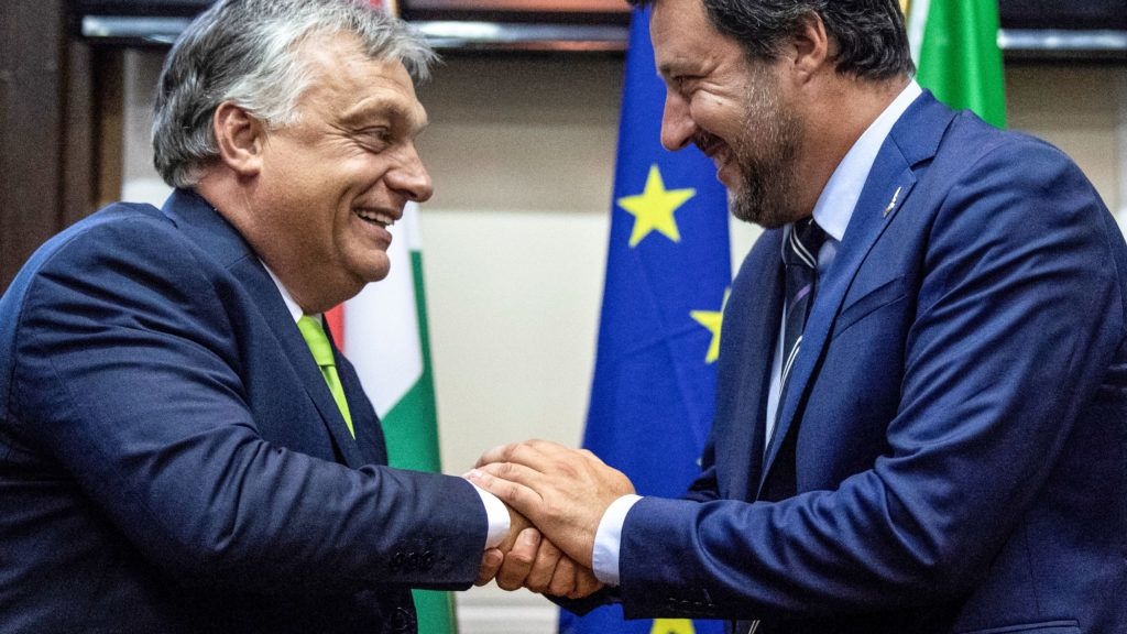 Italy's Interior Minister Matteo Salvini (R) shakes hands with Hungary's Prime Minister Viktor Orban at a press conference following a meeting in Milan on August 28, 2018. (Photo by MARCO BERTORELLO / AFP)