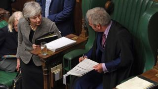 """A handout photograph released by the UK Parliament shows Britain's Prime Minister Theresa May (L)  talking to speaker of the House, John Bercow as she arrives to make a statement to the House of Commons in London on December 17, 2018, following her attendance at an EU Summit last week. - Prime Minister Theresa May will on Monday warn MPs against supporting a second Brexit referendum, as calls mount for a public vote to break the political impasse over the deal she struck with the EU. """"Let us not break faith with the British people by trying to stage another referendum,"""" she will tell parliament, according to extracts from her speech released by Downing Street. (Photo by Jessica TAYLOR / UK PARLIAMENT / AFP) / RESTRICTED TO EDITORIAL USE - NO USE FOR ENTERTAINMENT, SATIRICAL, ADVERTISING PURPOSES - MANDATORY CREDIT """" AFP PHOTO / Jessica Taylor /UK Parliament"""""""