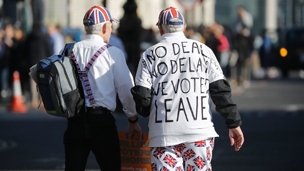 Pro-Brexit activists march outside the Houses of Parliament in central London on February 27, 2019. - Prime Minister Theresa May will today face a vote by MPs over her newly revised Brexit strategy, which allows for a possible request to delay Britain's EU departure if her divorce deal is not approved. (Photo by Tolga AKMEN / AFP)