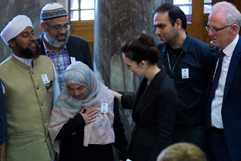 """New Zealand Prime Minister Jacinda Ardern (C) meets with Muslim community leaders after the Parliament session in Wellington on March 19, 2019. - Ardern vowed never to utter the name of the twin-mosque gunman as she opened a sombre session of parliament with an evocative """"as salaam alaikum"""" message of peace to Muslims. (Photo by David LINTOTT / AFP)"""