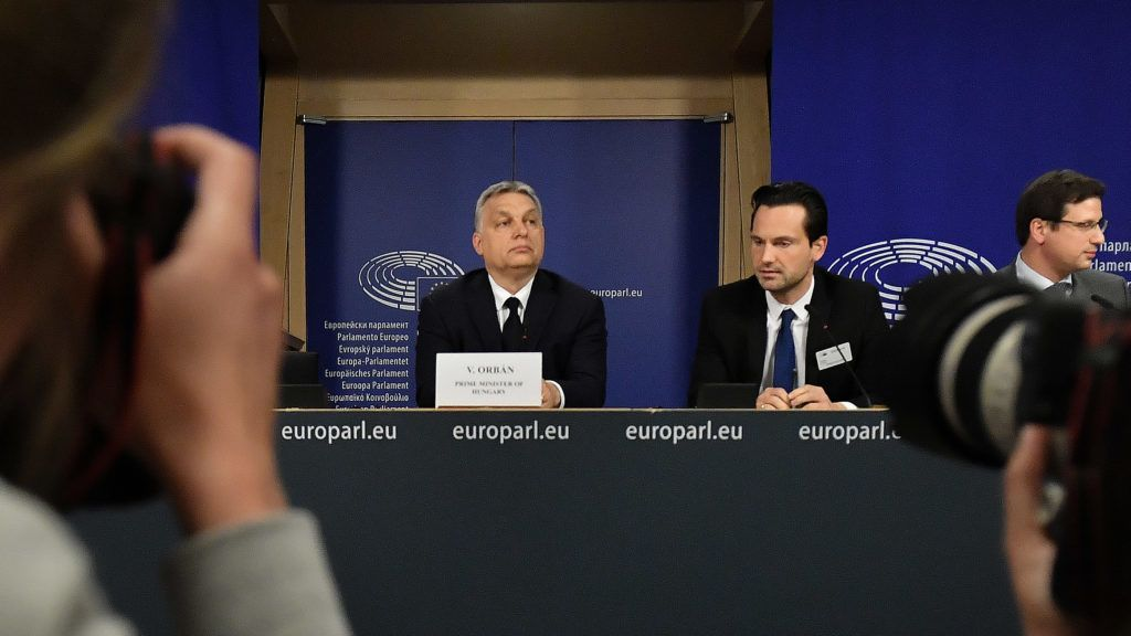 Hungary's Prime Minister Victor Orban (C) addresses a press conference at the end of a European People's Party (EPP) meeting at the European Parliament in Brussels on March 20, 2019. - The Fidesz party of firebrand Hungarian Prime Minister Viktor Orban was hit with a temporary suspension from the European People's Party. Fidesz had faced expulsion after running a controversial billboard campaign that accused European Commission head Jean-Claude Juncker and liberal US billionaire George Soros, a bete-noir of Orban, of plotting to flood Europe with migrants. (Photo by EMMANUEL DUNAND / AFP)