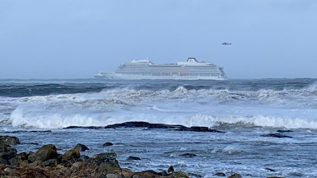 """The cruise ship Viking Sky is pictured on March 23, 2019 near the west coast of Norway at Hustadvika near Romsdal. - Emergency services said on March 23, 2019 they were airlifting 1,300 passengers off a cruise ship off the Norwegian coast.The Viking Sky cruise ship sent an SOS message due to """"engine problems in bad weather"""", southern Norway's rescue centre said on Twitter, while police reported the passengers would be evacuated by helicopter. (Photo by Odd Roar LANGE / NTB Scanpix / AFP) / Norway OUT"""