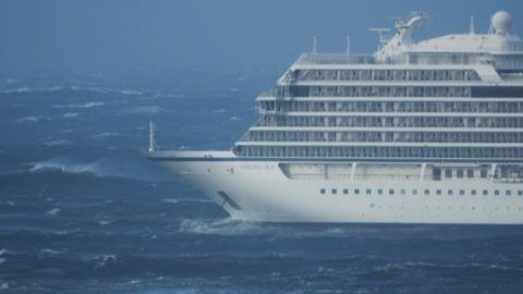 """The cruise ship Viking Sky is pictured on March 23, 2019 near the west coast of Norway at Hustadvika near Romsdal. - Emergency services said on March 23, 2019 they were airlifting 1,300 passengers off a cruise ship off the Norwegian coast. The Viking Sky cruise ship sent an SOS message due to """"engine problems in bad weather"""", southern Norway's rescue centre said on Twitter, while police reported the passengers would be evacuated by helicopter. (Photo by Frank Einar VATNE / NTB Scanpix / AFP) / Norway OUT"""