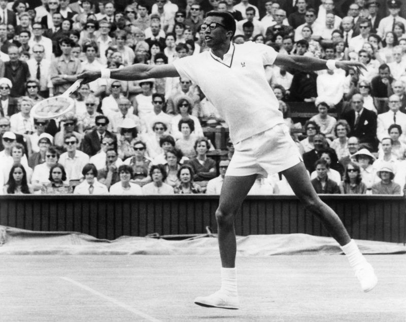 Unlocated picture taken in the 1968s of American famous tennis player Arthur Ashe who return the ball to his opponent as he was the first African-American on the U.S. Davis Cup. Ashe (1943-1993) won 27 of 32-Cup single matches in fifteen years, winning the Davis Cup six times. Ashe's greatest triumph was in 1975 when he defeated the game's most dominant player; Jimmy Connors, in the Wimbledon finals. (Photo by STAFF / AFP)