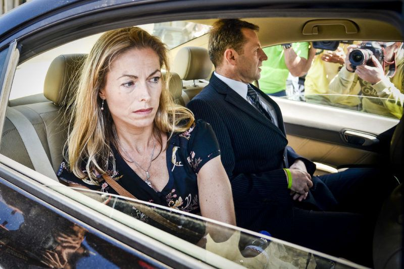 Kate McCann (L) and her husband Gerry McCann (R), parents of missing British youngster Madeleine McCann, leave the court house in Lisbon after delivering statements in their case against Portuguese police officer Goncalo Amaral on July 8, 2014. The McCanns, whose daughter Madeleine disappeared in Portugal in 2007, are suing Goncalo Amaral for libel and had flown from England to Lisbon to deliver personal impact statements at the Palace of Justice. Madeleine disappeared from a bedroom of her family's holiday apartment in the Algarve resort of Praia da Luz a few days short of her fourth birthday as her parents dined with friends at a nearby tapas restaurant.  AFP PHOTO / PATRICIA DE MELO MOREIRA (Photo by PATRICIA DE MELO MOREIRA / AFP)