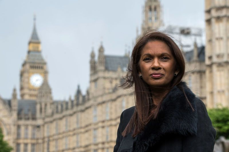 """Businesswoman, Gina Miller speaks during a television interview on College Green in London on April 26, 2017. - A businesswoman who took the British government to court to force a parliamentary vote on the UK's split from the EU launched a campaign on April 26, 2017 to oppose an """"extreme Brexit"""". Gina Miller said her Best For Britain initiative would target marginal seats in the June 8 general election. (Photo by CHRIS J RATCLIFFE / AFP)"""