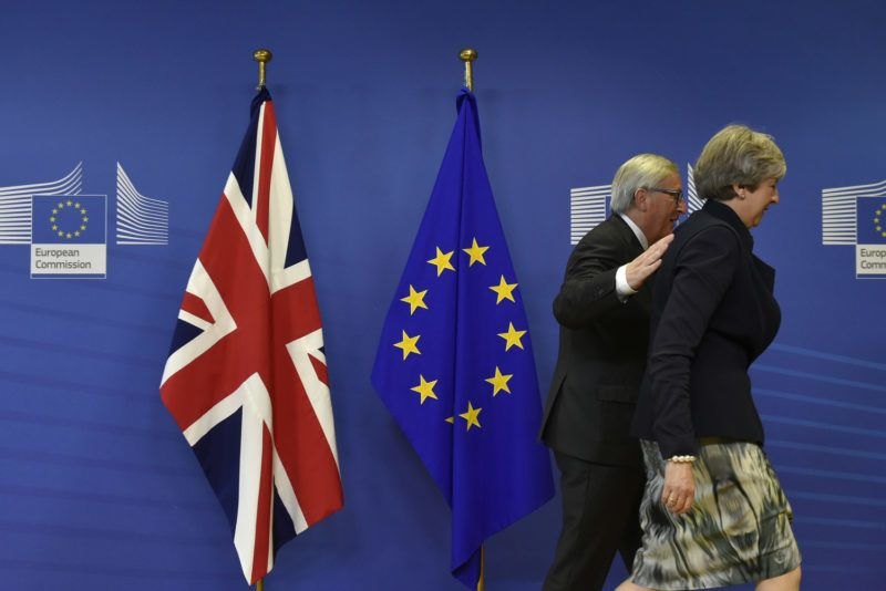 """British Prime Minister Theresa May (R) and European Commission chief Jean-Claude Juncker arrive for a Brexit negotiation meeting on December 4, 2017 at the European Commission in Brussels. - British Prime Minister Theresa May meets European Commission chief Jean-Claude Juncker on December 4 as an """"absolute"""" deadline to reach a Brexit divorce deal expires (Photo by JOHN THYS / AFP)"""