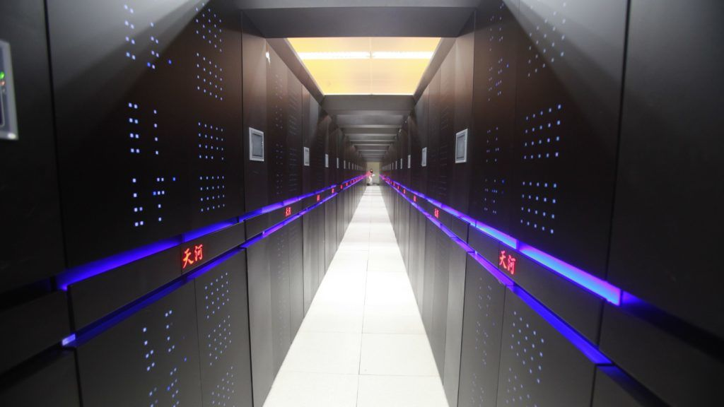 """Chinese-developed supercomputer Tianhe-2 or TH-2 operates at the National University of Defense Technology in Changsha city, central China's Hunan province, 14 June 2013.  China's Tianhe-2 supercomputer has retained its position as the world's most powerful system for the sixth consecutive time, according to a biannual Top500 list of supercomputers released Monday (16 November 2015). Tianhe-2, or Milky Way2, with a performance of 33.86 petaflops per second (Pflop/s), was developed by China's National University of Defense Technology and deployed at the National Supercomputer Center in Guangzhou. It has held the title since June 2013. The Chinese system is almost twice as fast as the next on the list, Titan of the US Department of Energy, which has a performance of 17.59 Pflop/s. In fact, there has been no change among the ranking of the world's top5 supercomputers since June 2013 in the latest edition of the closely watched list. """"The top five computers are very powerful and expensive,"""" Jack Dongarra, professor of the University of Tennessee and editor of the report, said in an email. """"It will take perhaps another year before a new system enters the top five."""""""
