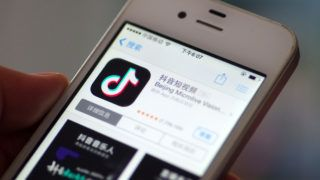 """--FILE--A netizen browses the mobile app of Tik Tok, an overseas iteration of short video app Douyin, of Beijing Bytedance Technology Co Ltd, in Ji'nan city, east China's Shandong province, 4 June 2018.  Musical.ly, the short-form video-sharing platform now owned by the Chinese company TikTok, has agreed to pay a $5.7 million fine to settle allegations by the US Federal Trade Commission (FTC) that the company has been illegally connecting user information from children under 13, according to a statement released by the FTC on Wednesday. According to the report, the allegations against Musical.ly say the company did not require children under 13 to gain parental approval to use the app, thus violating the Children's Online Privacy Protection Act (COPPA) in the US. Under COPPA, parental approval must be gained for users under the age of 13 before they share any sort of personal information with websites or apps. In a response to the allegation, TikTok issued a statement on Wednesday saying that the company has """"implemented changes to accommodate juvennile US users in a limited, separate app experience."""" It also claimed that additional protection of the safety and privacy of younger users has been introduced. According to a report by theverge.com, Musical.ly now needs to gain parental approval for users under 13 and all videos that were previously uploaded by this audience will also be taken down. Zhao Zhanling, a lawyer specializing in information technology and intellectual property rights, told the Global Times that the case demonstrates that despite tighter regulations in China covering the protection of personal information, Chinese companies still need to pay more attention to user privacy in overseas markets. That's especially the situation in Europe and the US, which have very strict protection of the personal information of children in terms of legislation and law enforcement."""