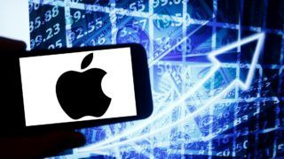 The logo of Apple is seen on a screen of a smartphone next to a screen with an illustration ofthe stock market. Apple is listed in Nasdaq. The Nasdaq is the second-largest stock exchange in the world after the New York Stock Exchange. (Photo by Alexander Pohl/NurPhoto)