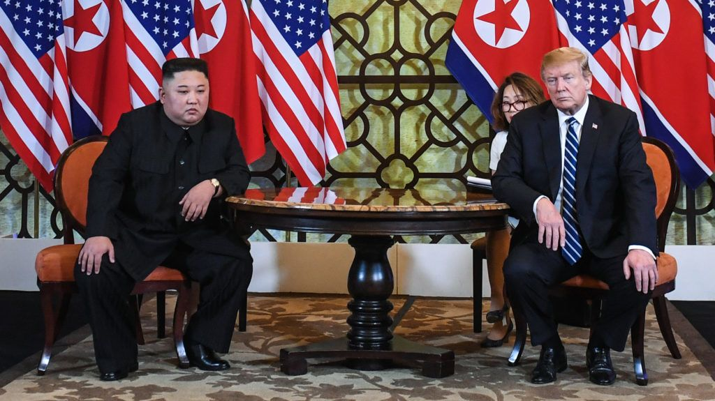 US President Donald Trump (R) and North Korea's leader Kim Jong Un hold a meeting during the second US-North Korea summit at the Sofitel Legend Metropole hotel in Hanoi on February 28, 2019. (Photo by Saul LOEB / AFP)