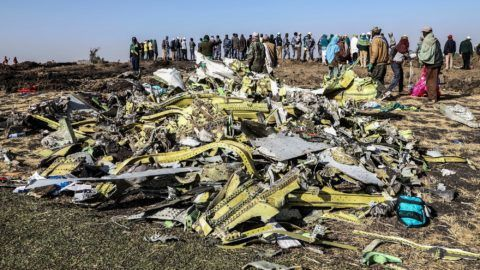 People stand near collected debris at the crash site of Ethiopia Airlines near Bishoftu, a town some 60 kilometres southeast of Addis Ababa, Ethiopia, on March 11, 2019. - An Ethiopian Airlines Boeing 737 crashed on March 10 morning en route from Addis Ababa to Nairobi with 149 passengers and eight crew believed to be on board, Ethiopian Airlines said. (Photo by Michael TEWELDE / AFP)