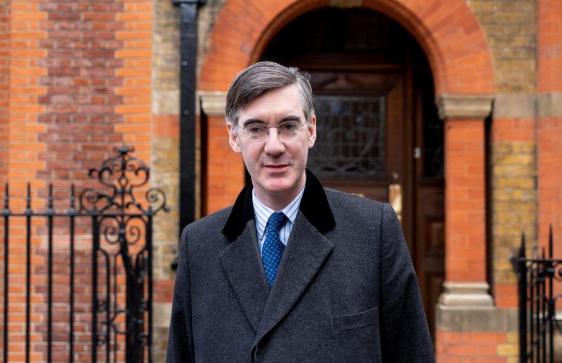 """British conservative MP Jacob Rees-Mogg, chair of the pro-Brexit European Research Group (ERG), leaves his residence in London on March 13, 2019. - British MPs will vote Wednesday on whether the country should leave the EU without a deal in just over two weeks, after overwhelmingly rejecting a draft divorce agreement. The House of Commons is expected to vote against a """"no deal"""" Brexit, although this could still happen on March 29 unless it can agree on what should happen instead. (Photo by Niklas HALLE'N / AFP)"""